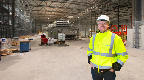 Dan Johannessen in front of corrugator and four level WIP field during works in progress